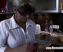 Matured stepmom comforting a scintillate hearted stepson