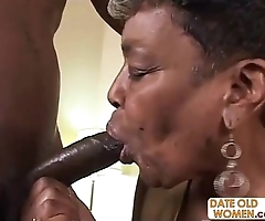 Black granny gets some youthful cock